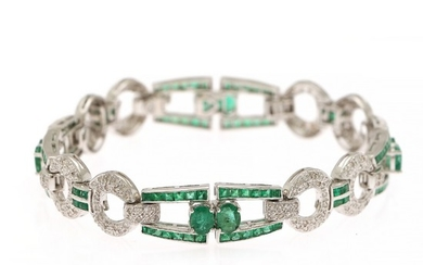 An emerald and diamond bracelet set with numerous emeralds and diamonds, totalling app. 2.20 ct., mounted in 18k white gold. H/SI-P1. L. 18 cm.