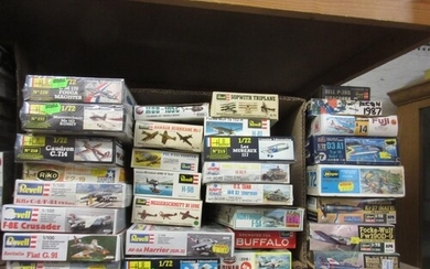 Approximately forty small boxed aircraft construction kits i...