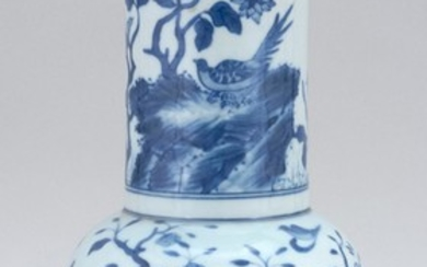 CHINESE BLUE AND WHITE PORCELAIN VASE In swallow-tail form, with decoration of a bird in a landscape. Six-character Qianlong mark on...