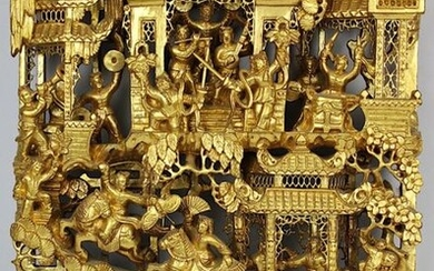 Chinese panel, wood richly carved and gilded, detailed openwork, stylized buildings in landscape, in it numerous fully plastic figures, musicians, dancers, actors, 43 x 30 cm, D 5 cm, few insignificant outbreaks. 2483-017