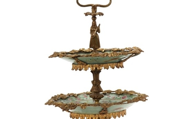 French gilt bronze etagere with Chinese porcelain plates. C. 1900. H. 46 cm.