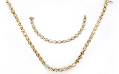 HALF SET comprising an 18K yellow gold NECKLACE made up of round links holding 7 brilliant-cut diamonds of approximately 0.25 carat and an 18K yellow gold BRACELET made up of round links holding 18 brilliant-cut diamonds of approximately 0.35 carat...
