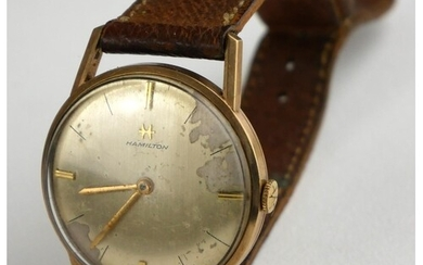 HAMILTON, A 9CT GOLD WATCH On leather strap, unmarked.