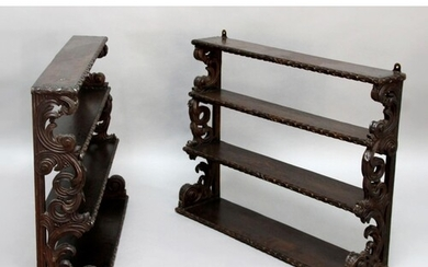 PAIR OF CARVED OAK HANGING WALL SHELVES, later 19th century,...