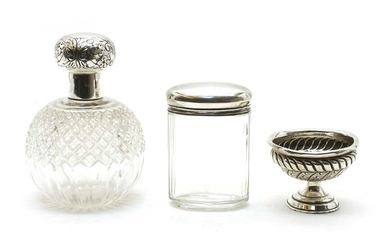 Two silver mounted cut glass dressing table bottles