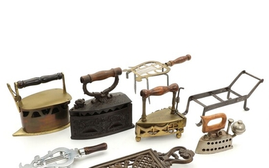 NOT SOLD. Various brass, wrought iron and steel flat irons and stands, wooden handles. Germany...