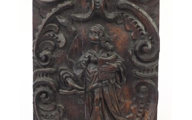 17th century oak panel carved with a saint, Suffolk House An...