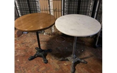 2 Cast iron base café tables one with marble other with timb...