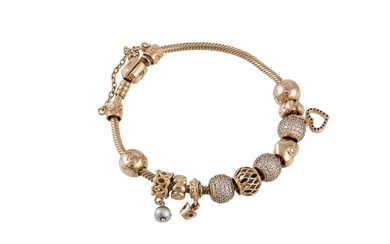 A 14CT GOLD CHARM BRACELET, by Pandora, with 12 charms and c...