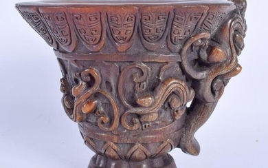 A CHINESE CARVED BUFFALO HORN STYLE LIBATION CUP