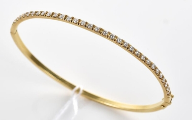 A DIAMOND BANGLE IN 18CT GOLD, TOTALLING 0.93CT, HALLMARKED LONDON 1988, DIAMETER 59MM, 7.8GMS