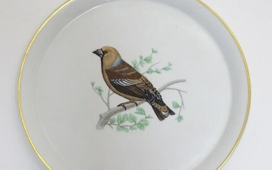 A French L Lourioux Le Faune plate with a gilt rim