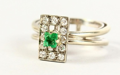A GOOD 18CT GOLD, EMERALD AND DIAMOND DESIGNER RING.