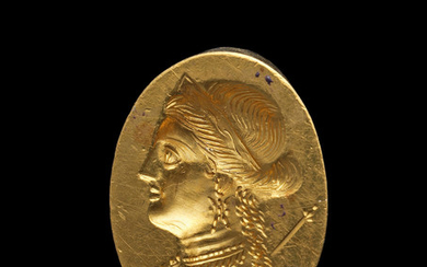 A Greek gold ring with a portrait bust of a Ptolemaic Queen
