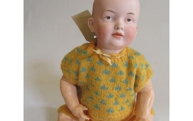 A Kley & Hahn bisque socket head baby doll with painted eyes...
