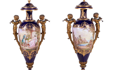 A Pair of Sèvres Style Gilt Bronze Mounted Painted and Parcel Gilt Porcelain Urns