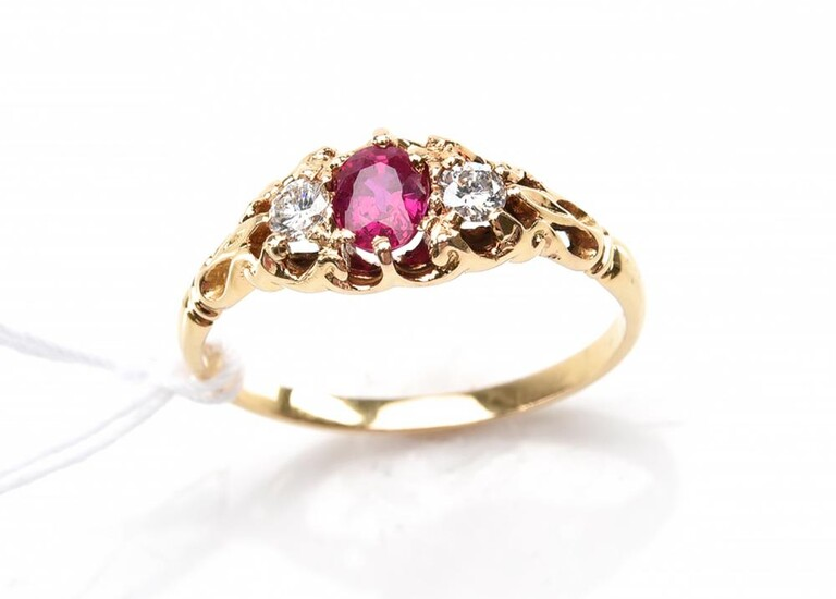 A RUBY AND DIAMOND DRESS RING, THE OVAL CUT RUBY ESTIMATED 0.54CTS AND DIAMONDS TOTALLING 0.16CTS, IN 18CT GOLD, SIZE N, 2.5GMS