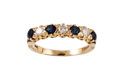 A SEVEN STONE DIAMOND AND SAPPHIRE RING, mounted in yellow g...