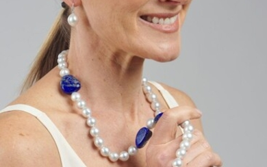 A SOUTH SEA PEARL, DIAMOND AND LAPIS-LAZULI BEAD NECKLACE COMPRISING FIFTY NINE SEMI-BAROQUE PEARLS MEASURING 10MM TO 12MM, SPACED W...