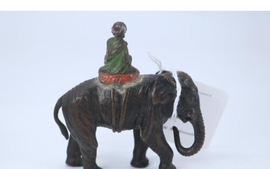A cold painted bronze model of an elephant and attendant, pa...