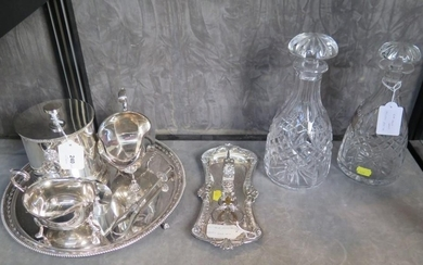 A collection of silver plate to include a candle snuffer and...