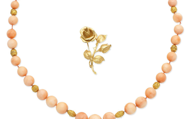 A coral bead necklace, and a rose brooch