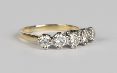 A gold and diamond five stone ring, claw set with circular cut diamonds graduating to the centre, un