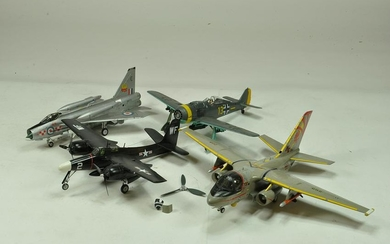 A group of plastic larger scale plastic kits.