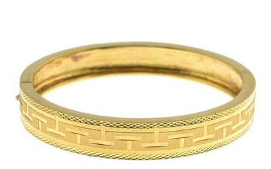 A hinged bangle.Oriental marks to indicate high carat