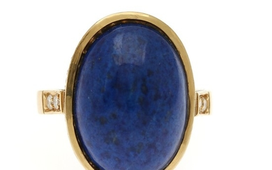 A lapis lazuli- and diamond ring set with a lapis lazuli encircled by numerous diamonds, mounted in 18k gold. Front 15.5×21 mm. Size 55.
