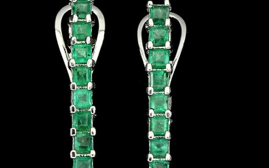 A pair of emerald ear pendants each set with numerous emerald-cut emeralds, mounted in rhodium plated sterling silver. L. 2.3 cm. (2)