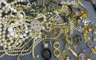 A quantity of costume jewellery to include a silver cap badg...