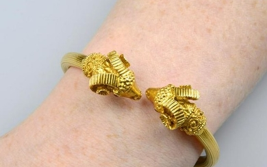 A ram's head hinged bangle, with ruby eyes, by Ilias