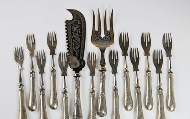 A set of twelve continental silver handled fish forks, each ...
