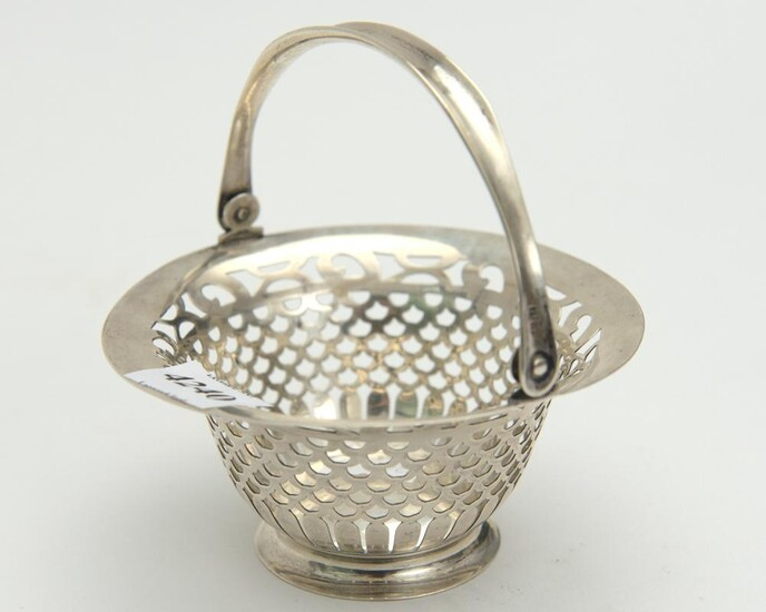 AN ENGLISH STERLING SILVER SWING HANDLED BASKET