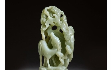 AN UNUSUAL PALE GREEN JADE 'DEER AND BAT' GROUP, QING DYNASTY, EARLY 18TH CENTURY