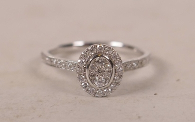 An 18ct white gold and diamond encrusted ring, approximately...