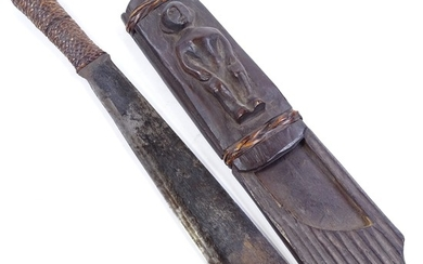 An Ethnic knife, with rattan-bound grip, original wood scabb...