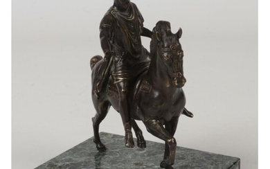 An early 20th century French patinated bronze equestrian fig...
