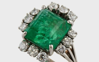 An emerald, diamond, and eighteen karat white gold