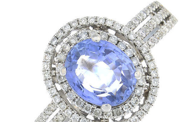 An oval-shape sapphire and brilliant-cut diamond cluster ring.