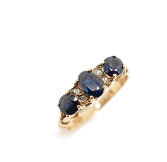 Blue and white spinel set 9ct rose gold ring marked 9ct GDNS...