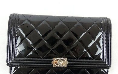 "CHANEL. ""Wallet on chain."" Black patent leather quilted..."
