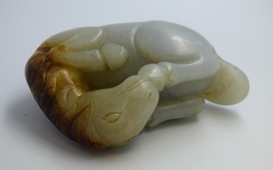 Carved Oriental jade model of a recumbent horse 11 cm