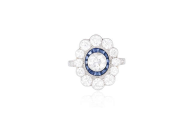 Description AN EARLY 20TH CENTURY SAPPHIRE AND DIAMOND CLUSTER...