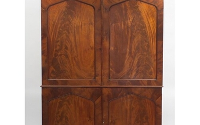 Early 19th century flame mahogany linen press fitted with a ...