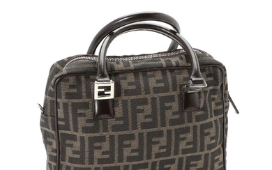 Fendi: A bag made of brown zucca printed canvas with dark brown leather trimmings and silver toned hardware.