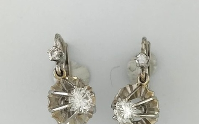 Pair of 750°/°°° white gold sleepers set with...