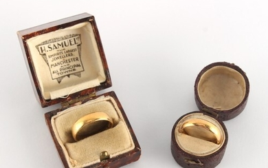 Property of a deceased estate - two plain 22ct yellow gold w...