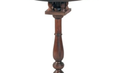 QUEEN ANNE CANDLESTAND In walnut and mahogany. Dish top with birdcage support. Turned pedestal raised on cabriole legs ending in mod...
